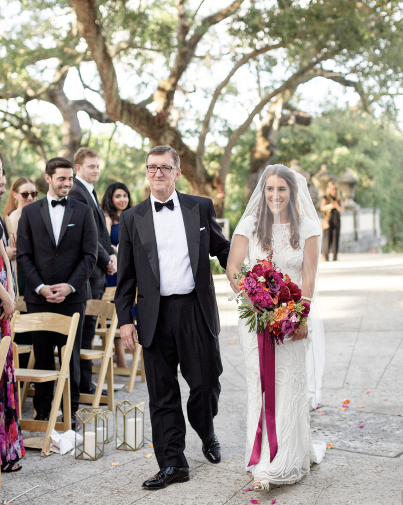 A unique Vizcaya Museum Wedding in Miami The Creatives Loft Weddings Miami bride arriving to the altar with father