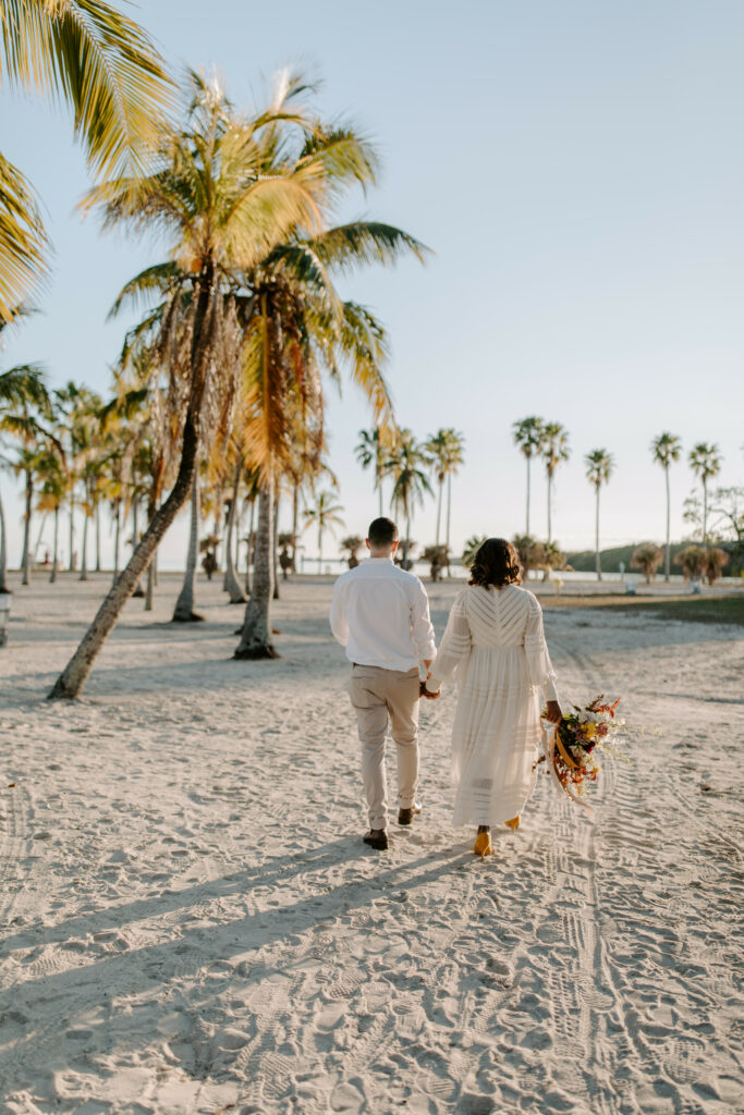 Miami Bohemian Elopement Wedding The Creative's Loft Couple Walking at the beach