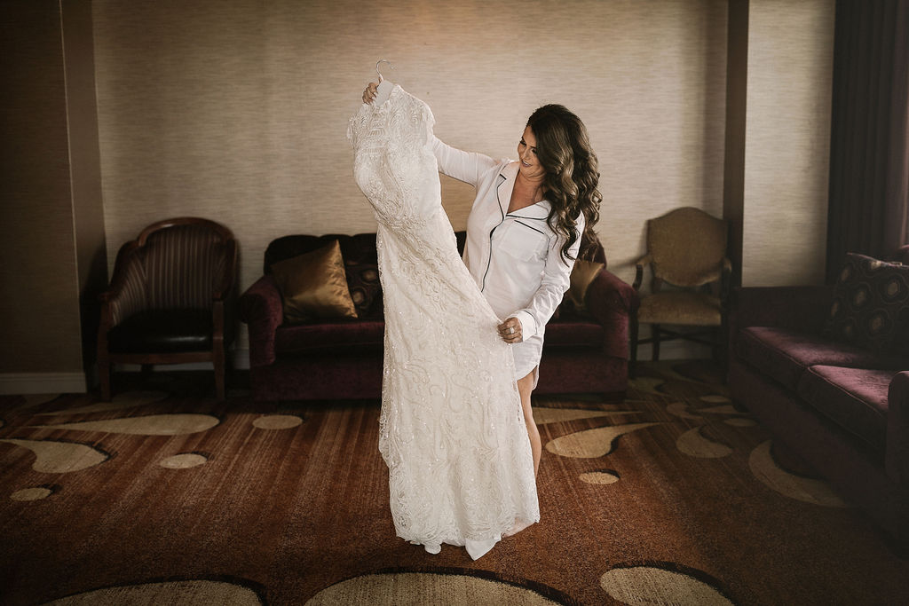 Miami Bride staring at her dress